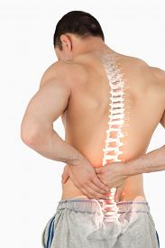 image of spine  - Digital composite of Highlighted spine of man with back pain - JPG