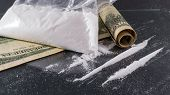 foto of meth  - Big Bag and lines of cocaine on a glass surface with a rolled up one hundred dollar bill - JPG