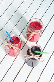 image of mason  - Blueberry and raspberry jam in mason jar on white wooden background - JPG