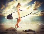 stock photo of board-walk  - Girl with surfboard walking on the beach - JPG