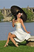 pic of pinup girl  - glamor portrait of a beautiful sultry pinup girl with a black parasol - JPG