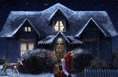 picture of gabled dormer window  - A winter house with santa standing outside reading a naughty and nice list and wandering up - JPG