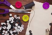 stock photo of tailoring  - Set of buttons for the repair of clothing and tailoring shears - JPG
