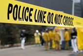 image of crime scene  - a police line in front of a hazmat decontamination shower - JPG