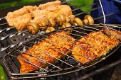 stock photo of grill  - Grilled salmon steaks on the grill - JPG