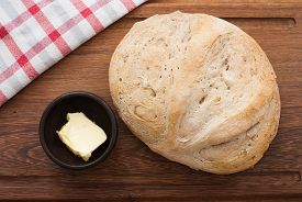 foto of home-made bread  - home made bread and butter on wooden board  - JPG
