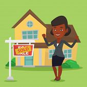 Excited african-american real estate agent standing in front of sold real estate placard and house.  poster