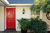 White Brick Front Porch With Red Door poster