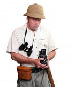 Photographer with vintage TLR camera dressed on suit for tropical destination. Studio shot isolated