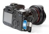 stock photo of megapixel  - Professional DSLR camera with inserted memory card - JPG