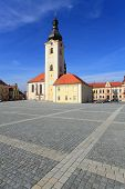 Famous ancient landmark. Baroque church of St. Nicholas on T.G.M. Square in Dobrany City, Czech Republic, Europe. poster