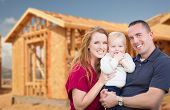 Happy Young Military Family Outside Their New Home Framing at the Construction Site. poster