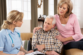 stock photo of health-care  - Senior Couple Talking To Health Visitor At Home - JPG