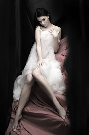 image of striper  - Beautiful slenderness young woman in bridal veil on pink background - JPG
