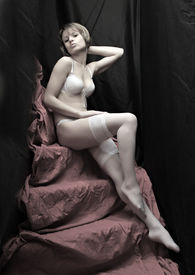 picture of striper  - Beautiful slenderness young girl in white nylons on pink background - JPG