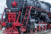 Big Steam Locomotive With A Red Star, Of Wheels, Wheels Of Old Steam Locomotives. A Pair Of Wheels.  poster