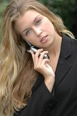 image of single woman  - female using cellphone - JPG