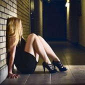 pic of high heels  - beautiful blond girl sitting on corridor floor - JPG