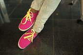 Gumshoes, Bright Pink Canvas Sneakers Or Sport Shoes With Yellow Laces And Fashionable Floral Jeans  poster
