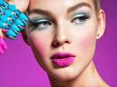 Closeup portrait of a beautiful fashion woman with bright makeup.  Gorgeous glamour girl of an attra poster