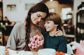 Little Boy And Mother Happy Together. Boy Gift Mother Flowers. Love With Mother And Son. Care Boy Wi poster