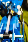 Agriculture Equipment Concept. Industrial Detailed Pneumatic, Hydraulic Silver Machinery Made Of Ste poster