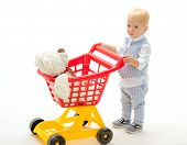 Happy Childhood And Care. Little Boy Child In Toy Shop. Shopping For Children. Savings On Purchases. poster