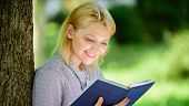 Best Self Help Books For Women. Girl Interested Sit Park Read Book Nature Background. Reading Inspir poster