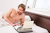 Man Writer Lay Bed White Bedclothes Working On New Book. Writer Author Used Old Fashioned Machine In poster