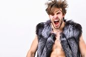 Guy Attractive Fashion Model Posing Fur Coat On Naked Body. Fashion Concept. Fashion And Pathos. Ric poster