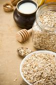 cereals oat flake and healthy food in plate on wood background
