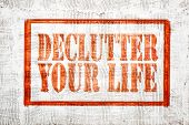 declutter your life - graffiti style sign on stucco wall poster