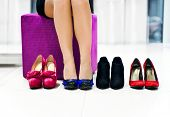 stock photo of stilettos  - The woman in shop chooses shoes - JPG