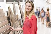 Portrait Of Confident Adult Female Customer In Hardware Store poster