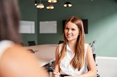 Businesswoman Interviewing Female Candidate At Graduate Recruitment Assessment Day In Office poster