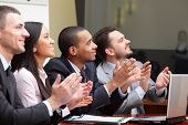 image of applause  - Multi ethnic business group greets somebody with clapping and smiling - JPG