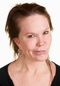 foto of cynicism  - Doubtful Caucasian woman in black over white background - JPG