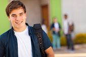 picture of classmates  - smiling teen boy carrying schoolbag - JPG