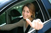 pic of seatbelt  - Cheerful girl sitting inside car with thumb up - JPG