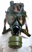pic of gas mask  - Little girl with gas mask on face pollution concept - JPG