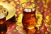 A blurred cup of an arabic tea