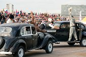 MOSCOW - AUG 25: Stuntmen depict a gunfight on old cars on Festival of art and film stunt Prometheus