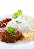stock photo of nasi  - Nasi lemak kukus traditional malaysian spicy rice dish - JPG