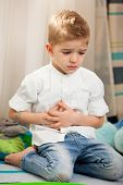 stock photo of belly-ache  - A five year old child having an abdominal pain - JPG