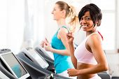 picture of treadmill  - Running on treadmill in gym or fitness club  - JPG