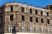 stock photo of tenement  - Old tenement under general repair in Katowice Silesia region Poland - JPG