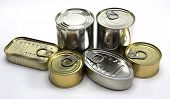 stock photo of hermetic  - Tins of different sizes and closed isolated on white background - JPG