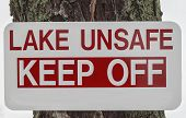 stock photo of unsafe  - Lake Unsafe Keep Off sign with bold red text - JPG