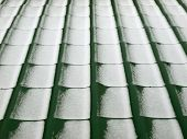 Metal Tile Roof In Winter Background