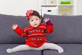 picture of leg-split  - Baby girl doing legs splits on sofa - JPG